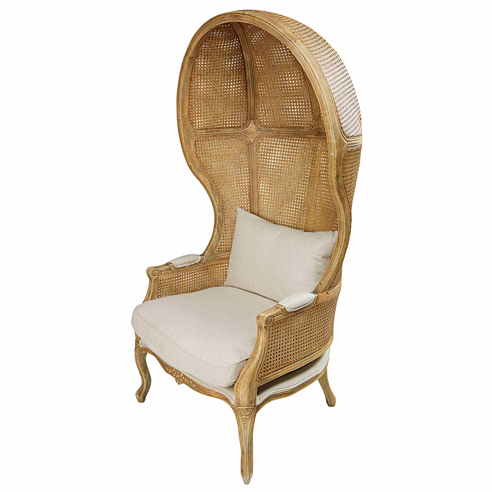 Rubber tree and antique rattan armchair